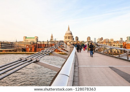 Millenium bridge and St Paul cathedral in London - stock photo