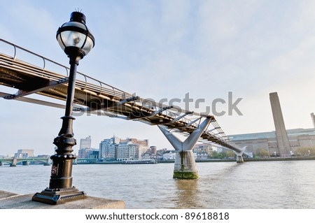 Millennium Bridge across thames river at London, England - stock photo