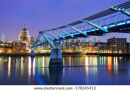 Millennium Bridge and Saint Paul Cathedral, London, UK - stock photo