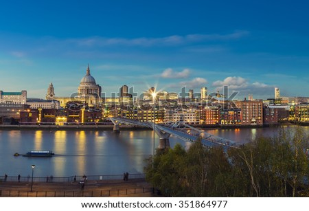 Millennium Bridge and St Paul's Cathedral of London after sunset - UK - stock photo
