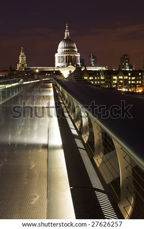 Millennium Bridge and St Paul's cathedral with ghostly figures passing the camera as it captures the image. - stock photo
