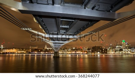 Millennium Bridge in London at Night - stock photo