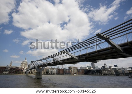 Millennium Bridge with St Pauls across River Thames - stock photo