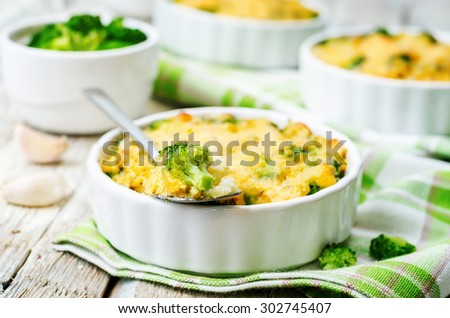 millet casserole with broccoli and cheese. the toning. selective focus - stock photo