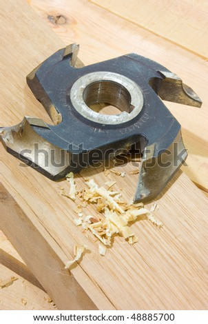 milling cutter on wood plank Woodworking tool - stock photo