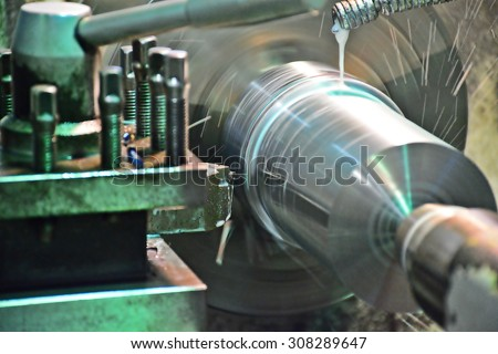 Milling machine operator working in factory workshop - stock photo