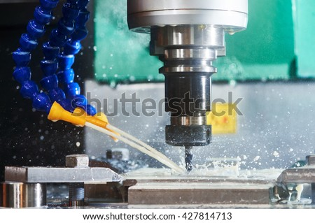 Milling metalworking process. Precision industrial CNC machining of metal detail by cutting mill at factory - stock photo