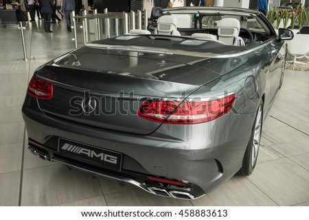MILTON KEYNES, ENGLAND - JULY 26, 2016. Rear view of Mercedes Benz 2016 E Class Cabriolet model at Mercedes-Benz head office  - stock photo