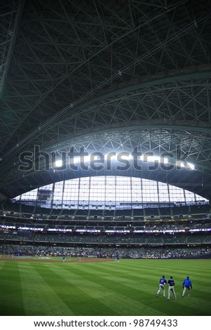MILWAUKEE - APRIL 24: The Brewers prepare to battle the Chicago Cubs under a closed dome at Miller Park on April 24, 2010 in Milwaukee, Wisconsin. The park opened in 2001 at a cost of $400 million. - stock photo