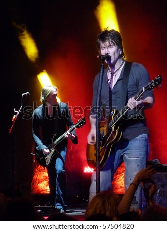 MILWAUKEE, WI - MAY 15: John Rzeznik performs with the Goo Goo Dolls at the Pabst Theater in Milwaukee, WI on May 15, 2010 as part of the Something for the Rest of Us World Tour. - stock photo