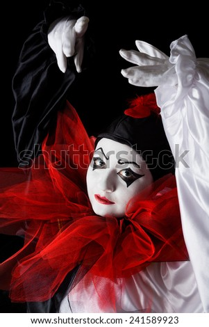 Mime actress in Pierrot costume performing a dance - stock photo