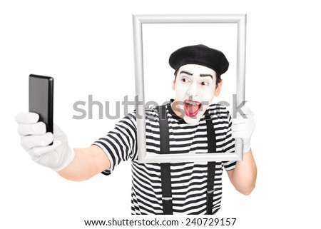 Mime artist taking selfie behind a picture frame isolated on white background - stock photo