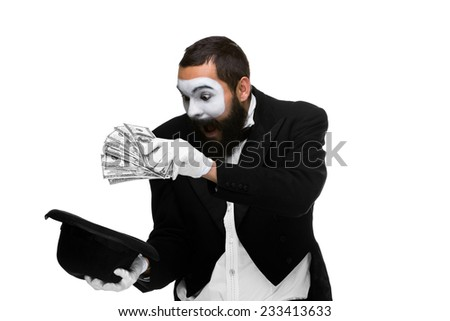 mime as a businessman laying dollars in hat isolated on a white background. concept of money luck - it's done - stock photo
