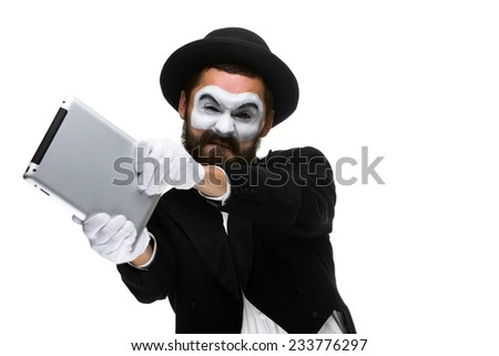 mime as a businessman throws computer in rage. Isolated on white background.  The concept of despair in business.  - stock photo