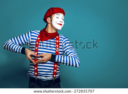 mime in red beret smiles - stock photo