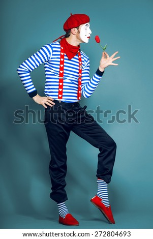 mime in red beret with flower - stock photo