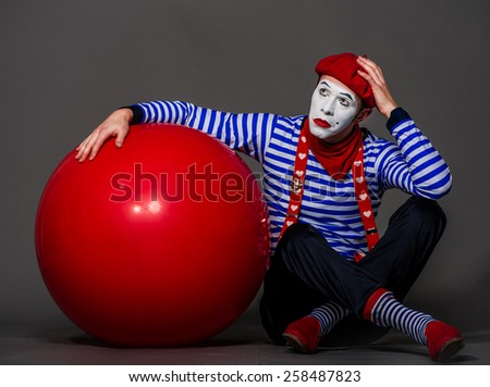 Mime with  big red ball in hands - stock photo