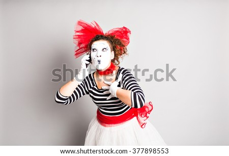 mime with smartphone. Concept of  April Fools Day. - stock photo