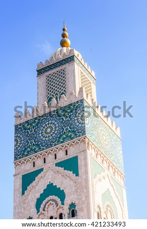 Minaret of the Hassan II Mosque or Grande Mosquee Hassan II, a mosque in Casablanca, Morocco. It is the largest mosque in Morocco and the 13th largest in the world. - stock photo