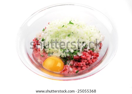 mince meat and broken chicken egg inside transparent bowl - stock photo