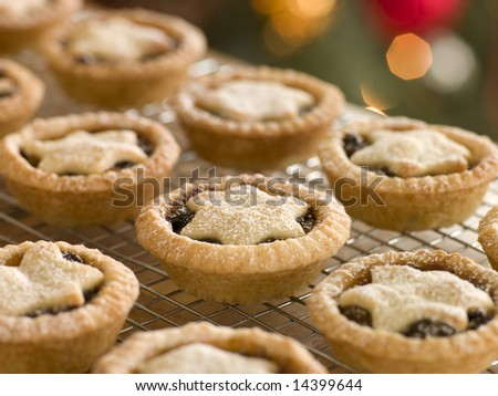 Mince Pies on a Cooling rack - stock photo