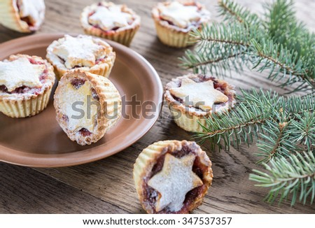 Mince pies with Christmas tree branch - stock photo