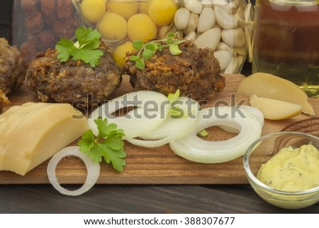 Minced, fried meat and cheese. Homework for the party. Burger with minced meat and cheese. - stock photo