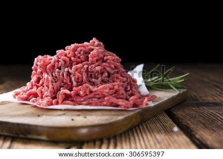 Minced Meat (Beef) as detailed close-up shot on dark wooden background - stock photo