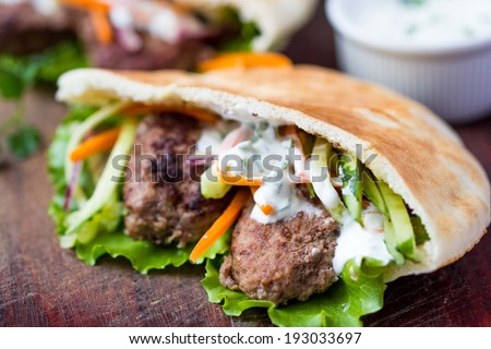 Minced meat kebab, beef balls in flat cake with vegetable, white sauce, spring picnic, Greek gyros - stock photo
