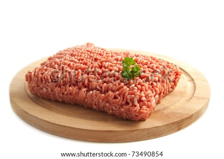 Minced meat on a wooden plate isolated over white - stock photo