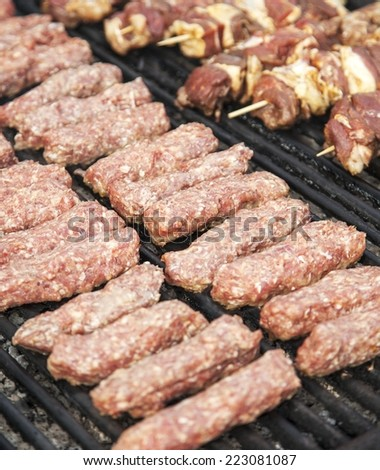 Minced meat rolls on grill, traditional romanian food - stock photo
