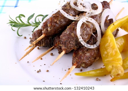 minced meat skewers with onion, green pepper and rosemary, close up - stock photo
