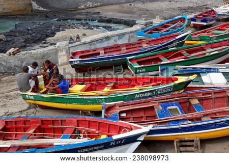 MINDELO, CAPE VERDE - DECEMBER 12: Fishermen sitting on fishing boats on Santo Antao island, Cape Verde (Cabo Verde), Africa - stock photo