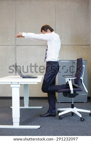 mindfulness  - young businessman taking short break for exercise in office work - stock photo
