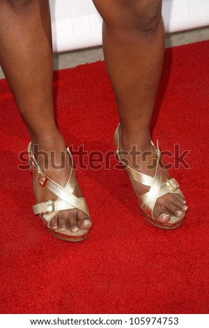Mindy Kaling's shoes at the 8th Annual Comedy for A Cure, a Benefit to raise Funds and Awareness for the Tuberous Sclerosis Alliance. Boulevard3, Hollywood, CA. 04-05-09 - stock photo
