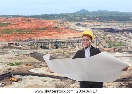 mine manager women at quarry looking future plan background of big mining coal - stock photo