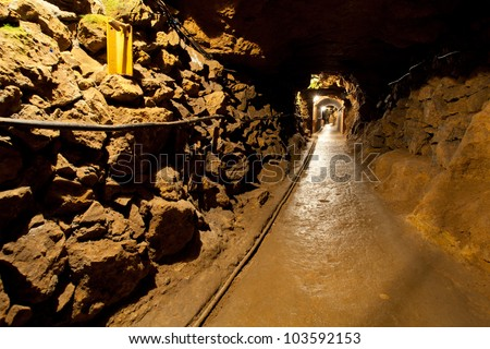 Mine tunnel with path - stock photo