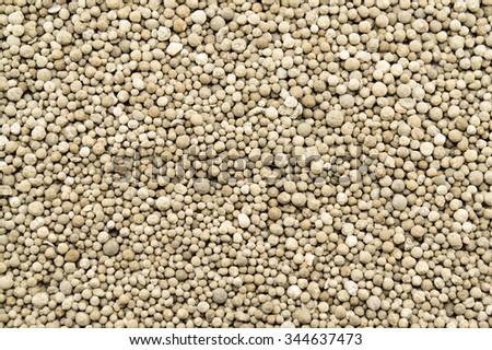 Mineral fertilizers balls. Background - stock photo