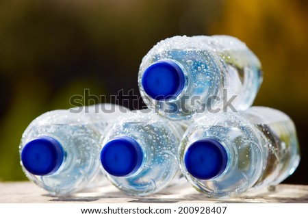 Mineral water bottles with blue plastic cork - stock photo