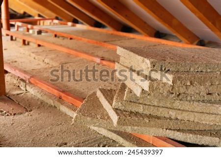 Mineral wool stack on construction site - thermal insulation of a house - stock photo