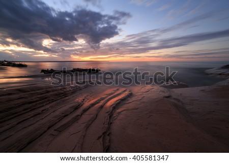 Miners Beach Sunset - Upper Peninsula of Michigan. Miners Beach is part of Pictured Rocks National Lakeshore near Munising Michigan - stock photo
