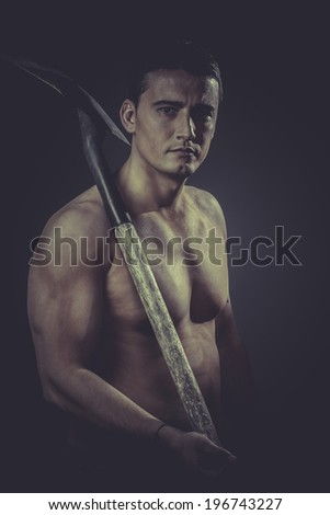 Miners Male worker holding a shovel, sexy builder - stock photo