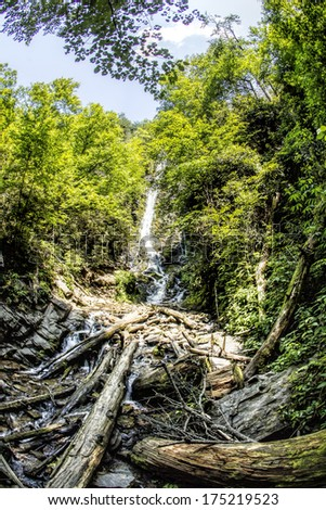 "Mingo Falls meaning ""Big Bear"" is located near in the Great Smoky Mountains near Cherokee, North Carolina. At 120 feet tall, it is one of the tallest waterfalls in the Southern Appalachians. - stock photo"