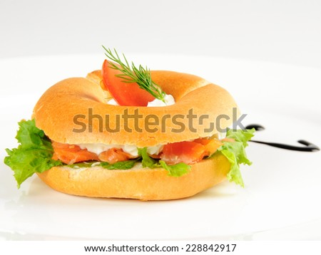 Mini Bagel with salmon and cottage cheese - stock photo