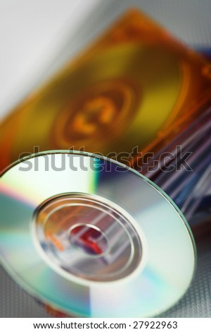 mini cd over stack of color cd boxes - stock photo