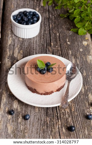 Mini-cheesecake and chocolate biscuits and blueberries, close up, vertical - stock photo
