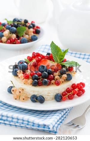 mini cheesecake with fresh berries on a plate, vertical, close-up - stock photo