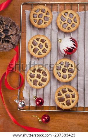 mini chocolate tarts on wooden background - stock photo