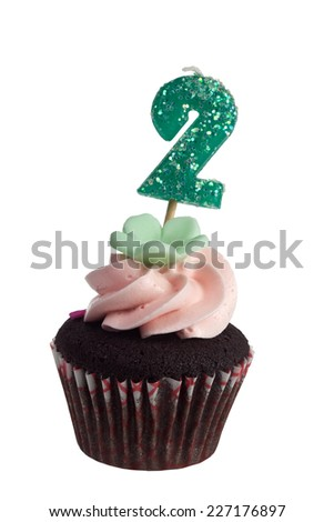 Mini cupcake with birthday candle for two year old isolated on white background  - stock photo