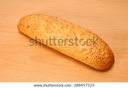 Mini French bread baguette with sesame seeds - stock photo